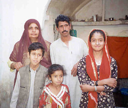 [Afghanistan] Focus on Hindus and Sikhs. - Daulat Raam and his family at their home in the backstreets of Kandahar