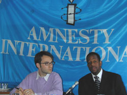[South Africa] Amnesty International's Eric Husketh (left) and Samkelo Mokhine at a press conference in Johannesburg