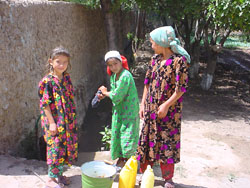 [Tajikistan] Girls collecting water.