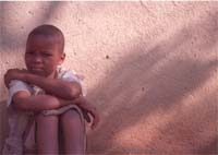 [Malawi] Orphan in Malawi. This 12-year old girl has been orphaned by AIDS in Malawi where the infection rate is 15%.
