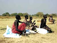 [Sudan] Women rest after receiving their monthly WFP food ration in Maiwut, Southern Sudan.