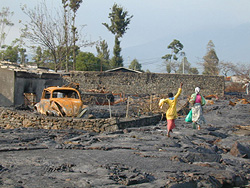 [DRC] Goma residents walk across cooled lava surface