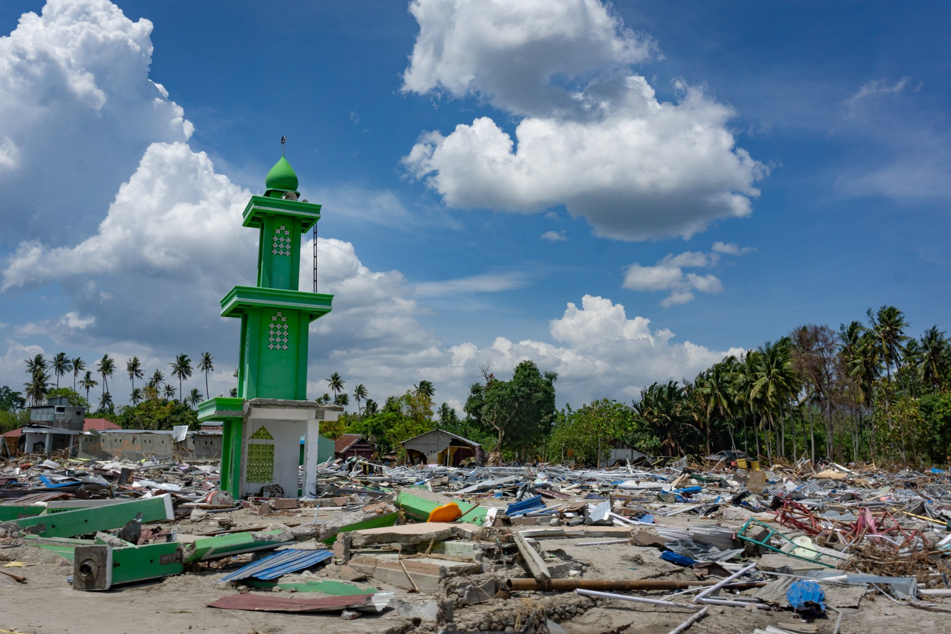 A single minaret stands among hundreds of flattened houses in Mamboro district, Palu, in Indonesia's Central Sulawesi province.