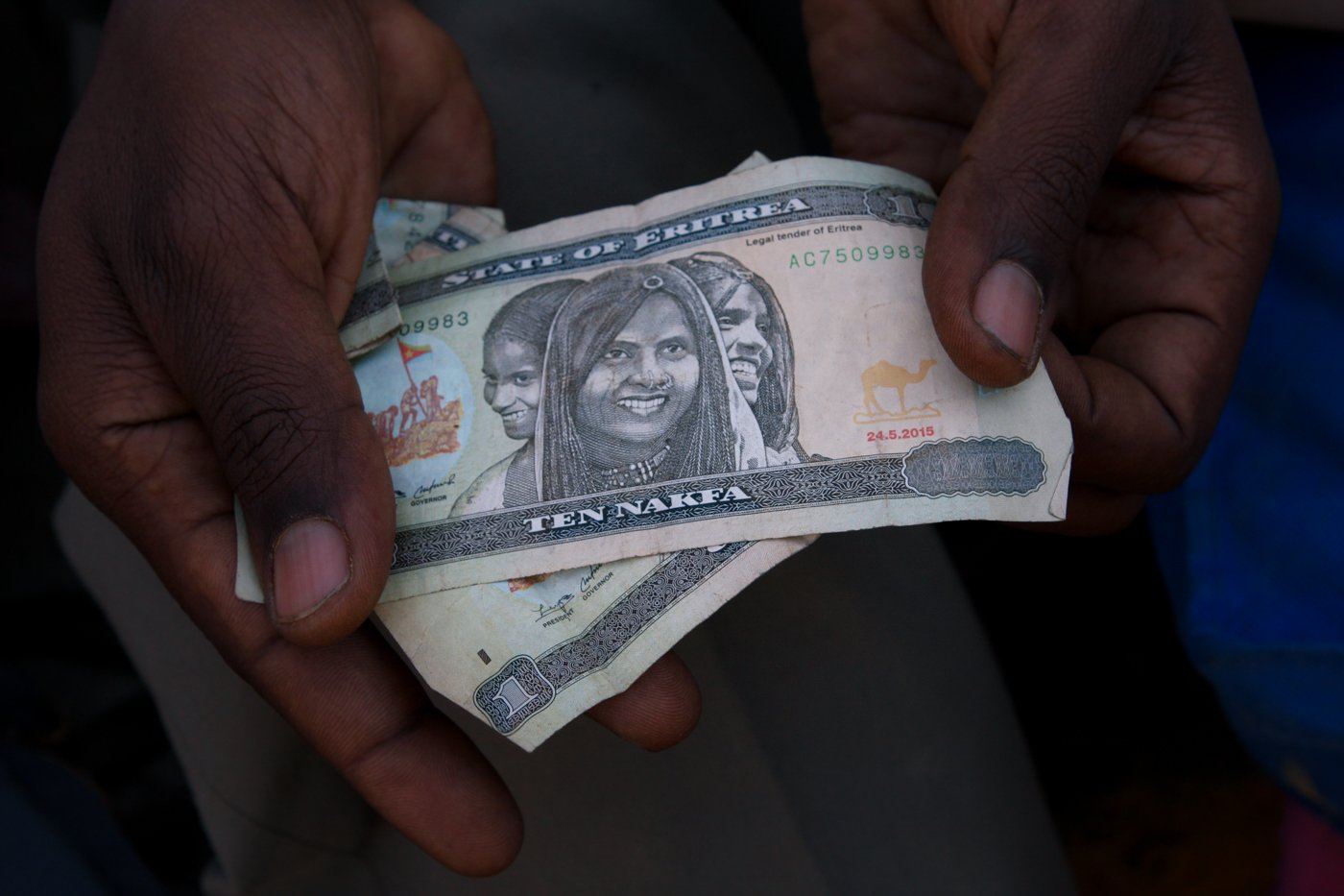 An Eritrean migrant newly arrived in Ethiopia shows the little money he has left