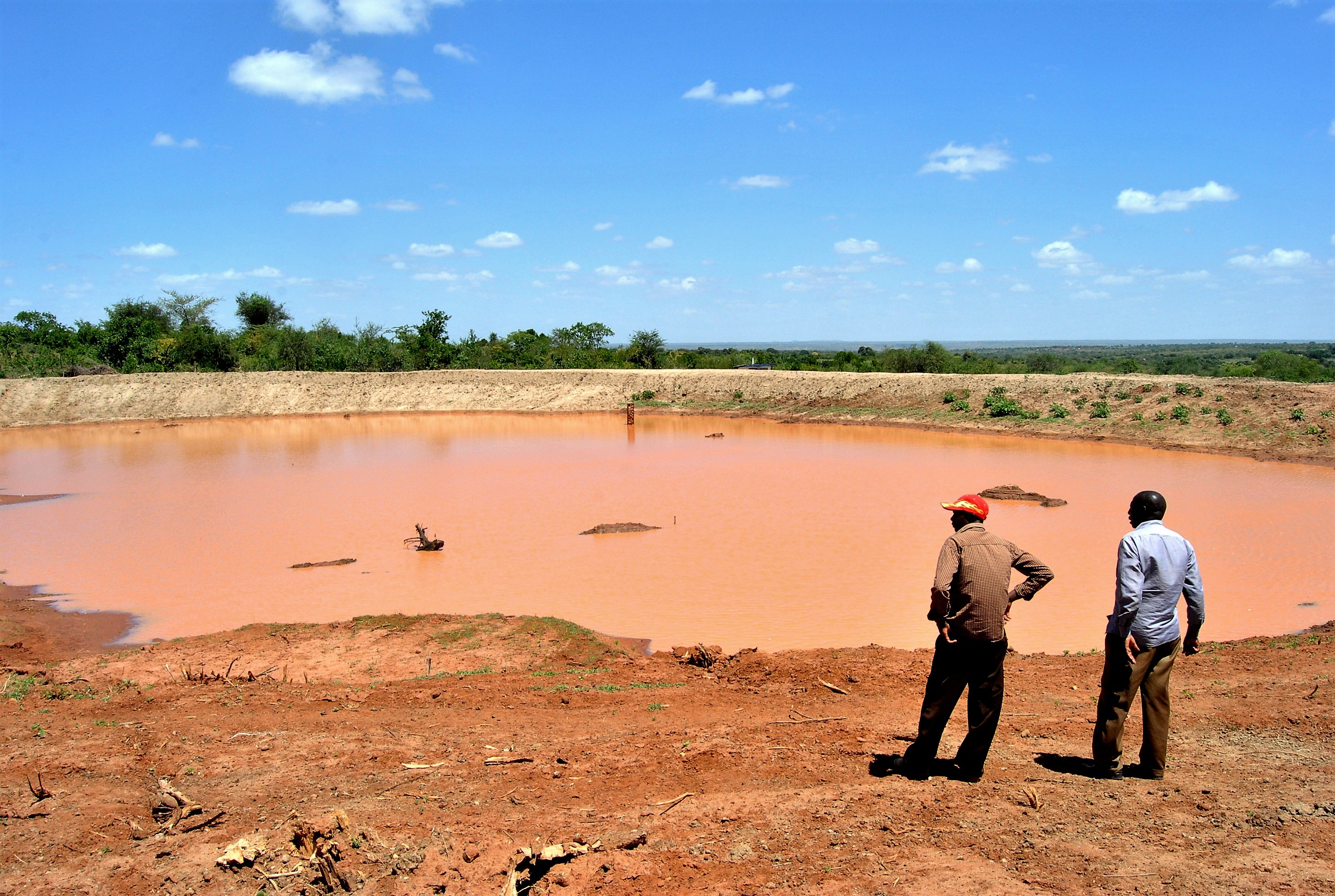 James Mbatha (Left), the secretary of the Nguu Masumba Ward Climate Change Committee with a fellow villager inspecting the Kwa Mutuku dam in Makueni.
