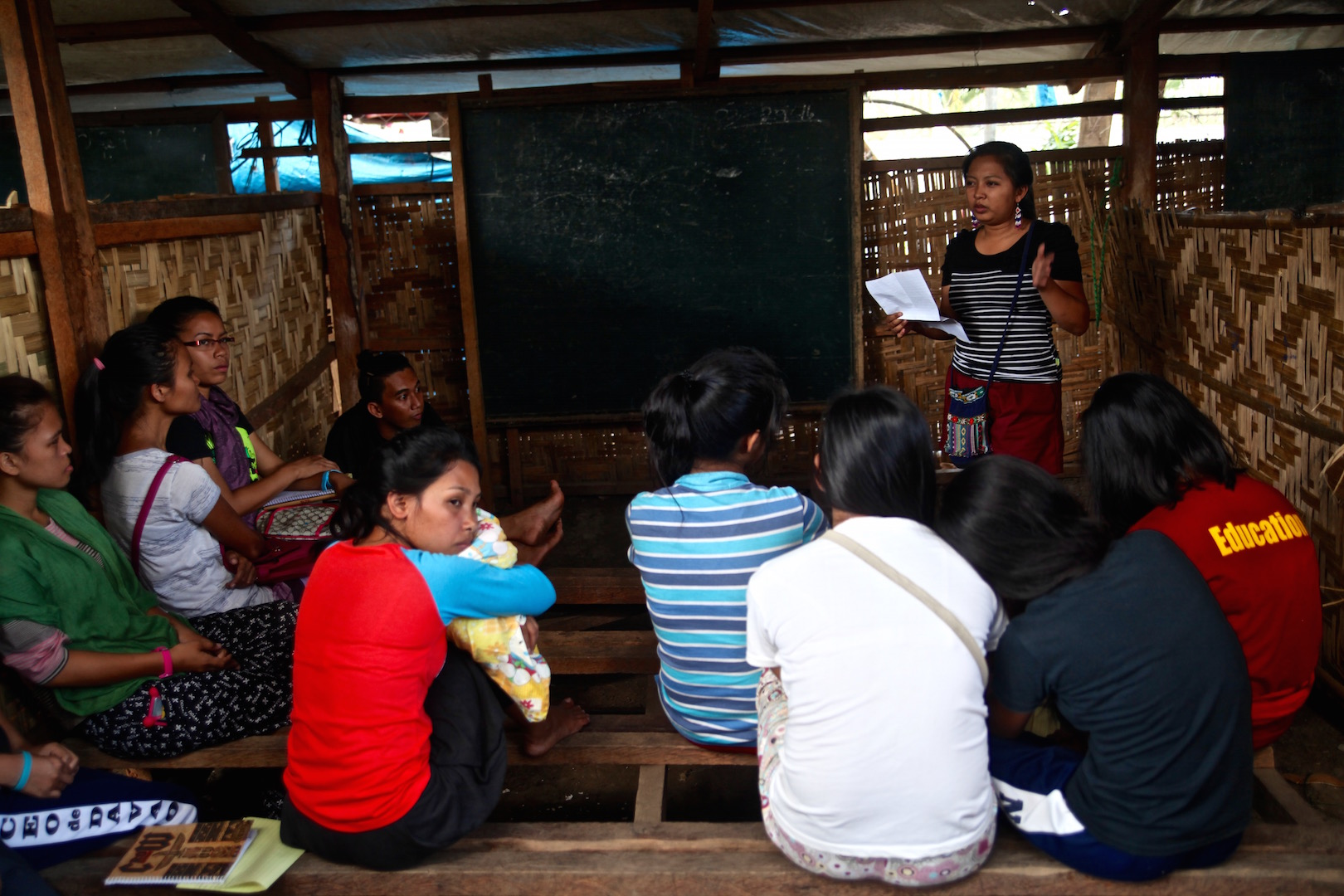Displaced indigenous people in a makeshift classroom