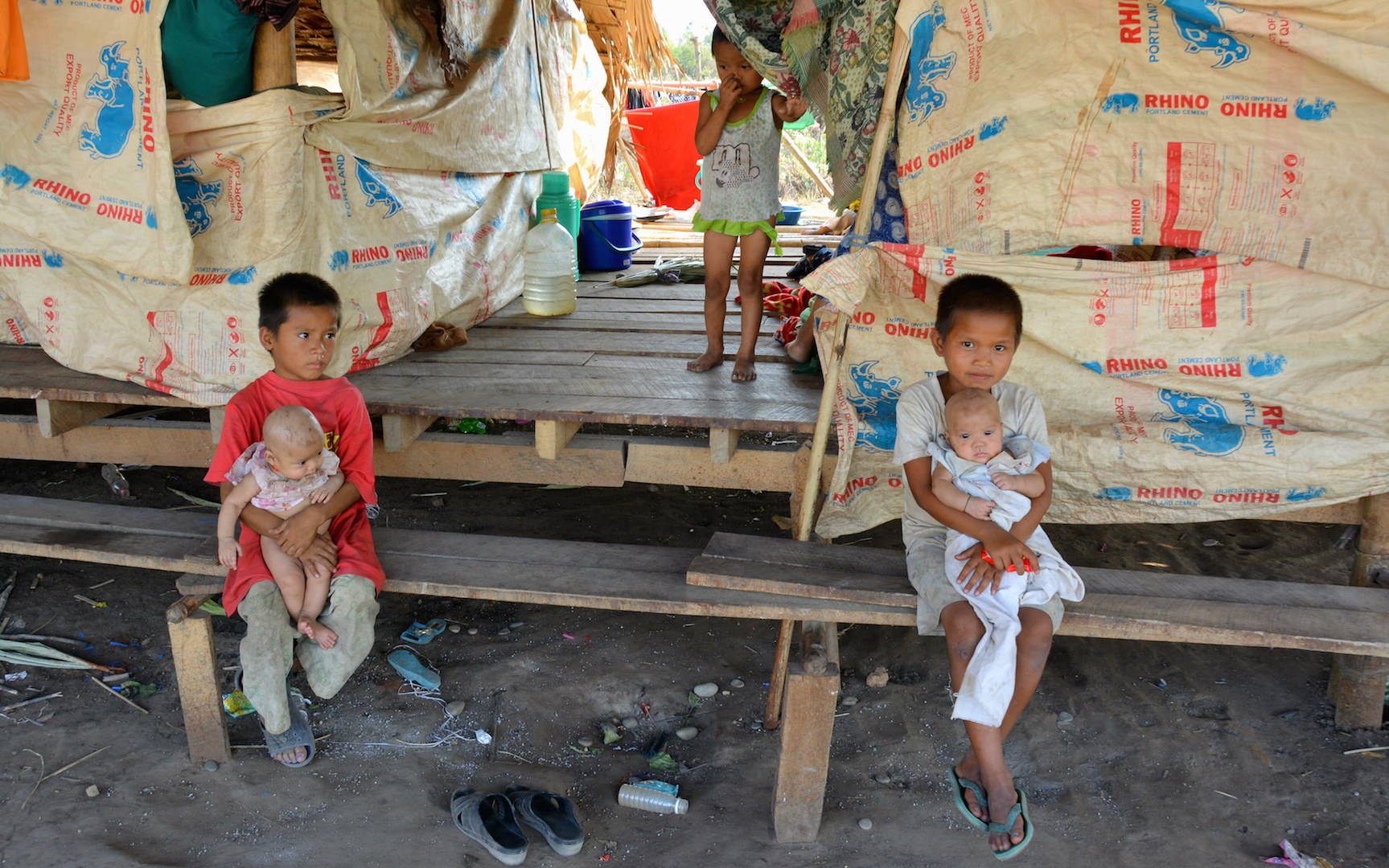 Children displaced by fighting in Myanmar's Kayin State in a makeshift shelter