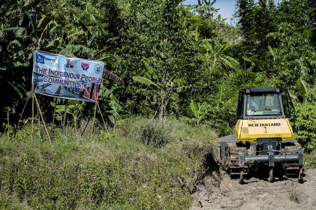 A bulldozer clears a road through indigenous ancestral land in the Philippines province of Compostela Valley in January 2016