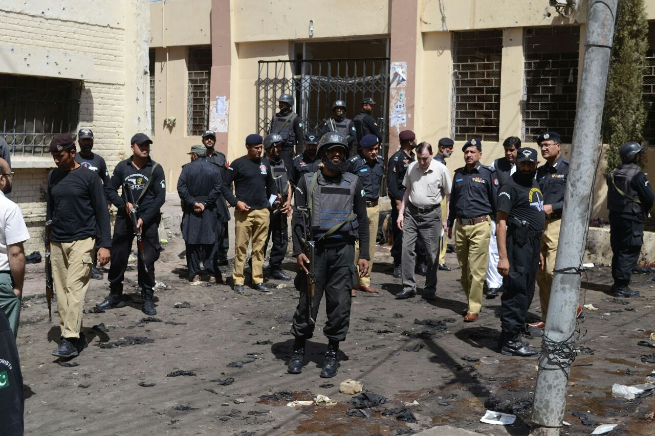 Police at the scene of the August bombing of a hospital in Quetta