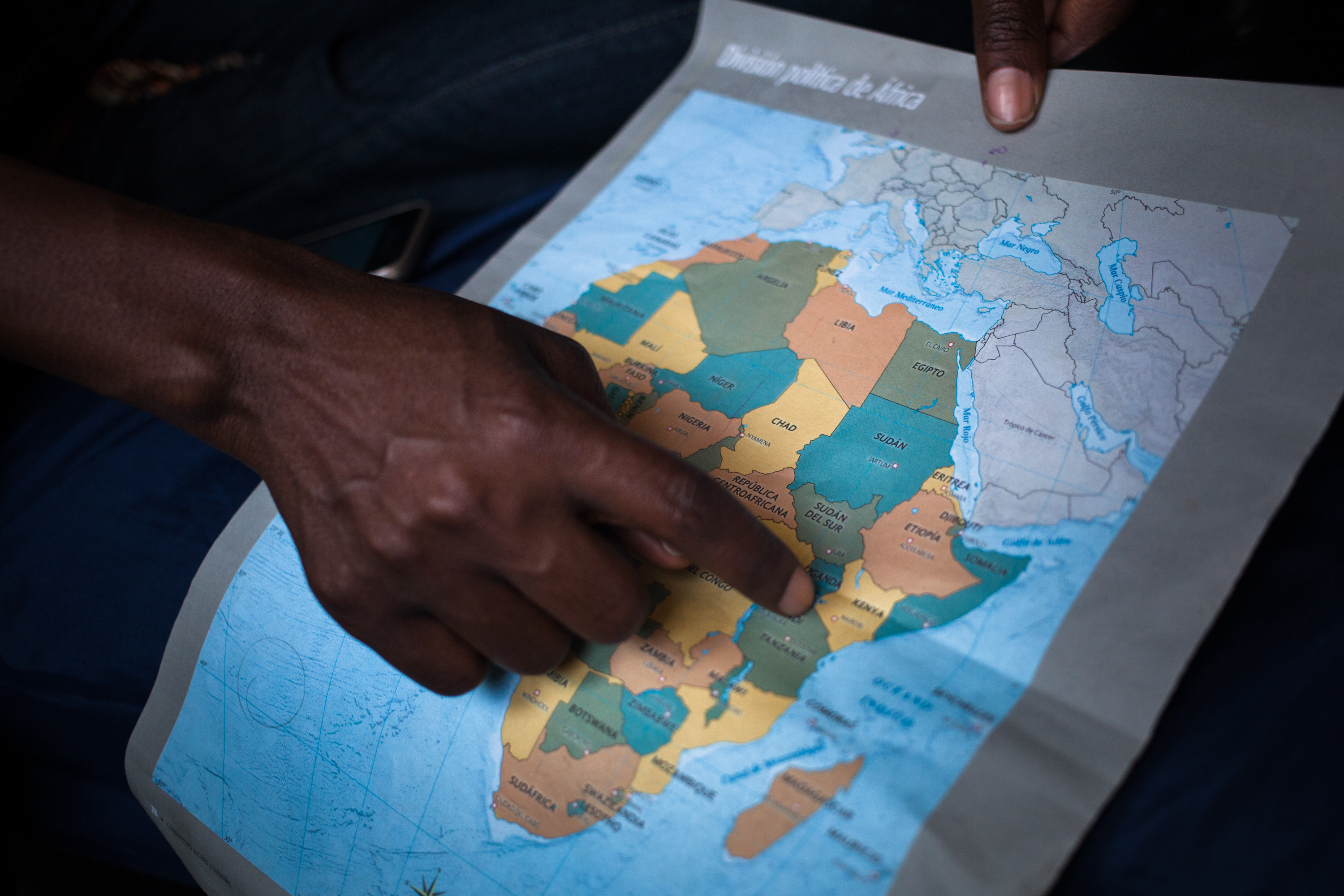 Woman pointing to a map of Africa