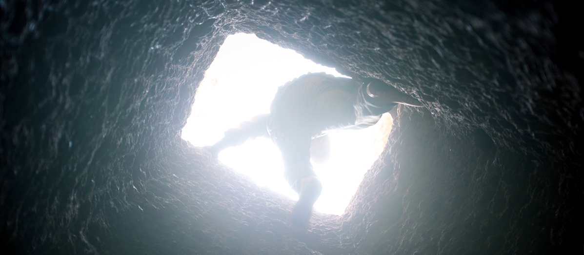 A miner works underground at a coltan mine in Kisengo, DRC