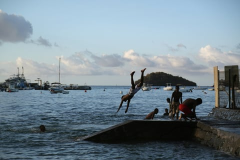 People jump into the sea on the French overseas island of Mayotte.
