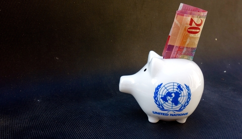 UN piggy bank with cash