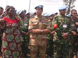[DRC] Petronille Vaweka (left), president of the interim administration of Ituri District, with UN troops in Bunia. She is also a deputy for Orientale Province in the DRC National Assembly, 1 September 2003.