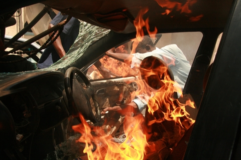 A man sets a car on fire during a demonstration after police had fired tear-gas to disperse the crowd at a funeral service for people killed in post-election violence in Nairobi, Kenya , January 2008.