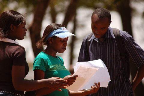 Students consult after re opening of the Kenyatta University, Kenya. February 2008. Kenyatta University is among the few public universities in the country that has re-opened following the post election violence.