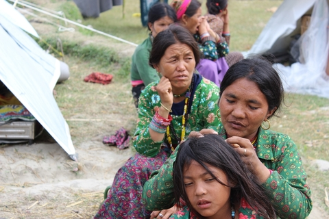 Mento Ghale (middle) and Rising Gyalmo in Nuwakot IDP camp
