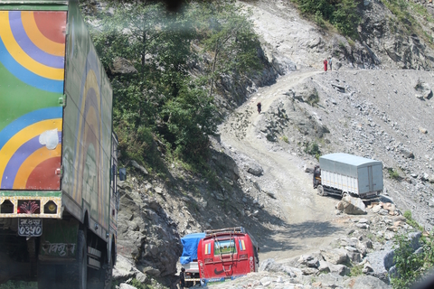 Trucks carrying relief supplies in the rural village of Dhunche in Nepal's Rasuwa district a month after the 25 April earthquake in 2015. Truck drivers often travel along very dangerous routes, which will only become more perilous once the imminent monsoo