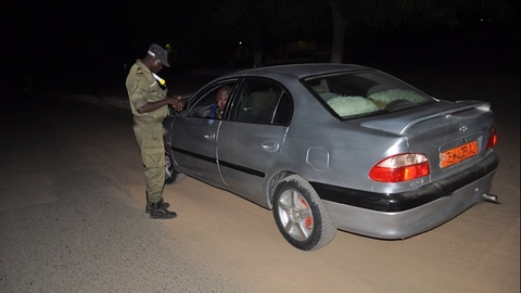 A police officer checks the papers of a motorist in Cameroon's Far North region, following an increase in check points, which are an attempt to thwart potential Boko Haram attacks.
