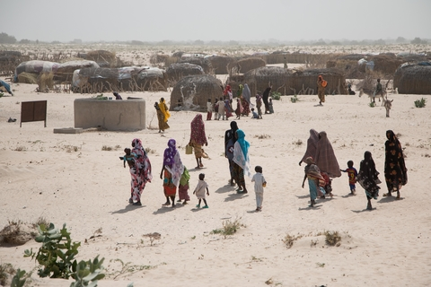 "Approaching the militarised ""red zone"" towards the border with Niger, displaced families gather for another distribution of cash handouts."