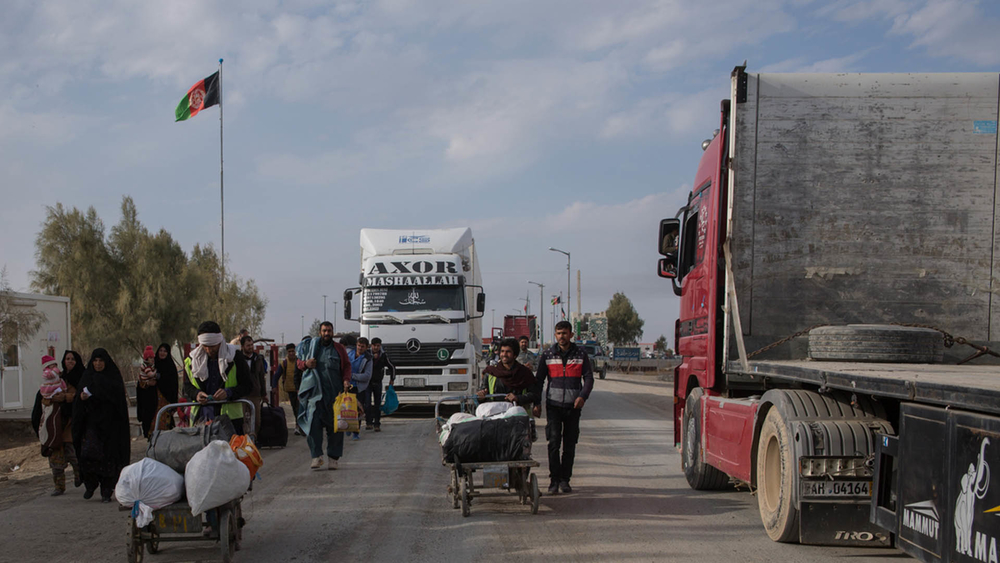 People return from Iran at a border crossing near Zaranj in Afghanistan's Nimroz Province.