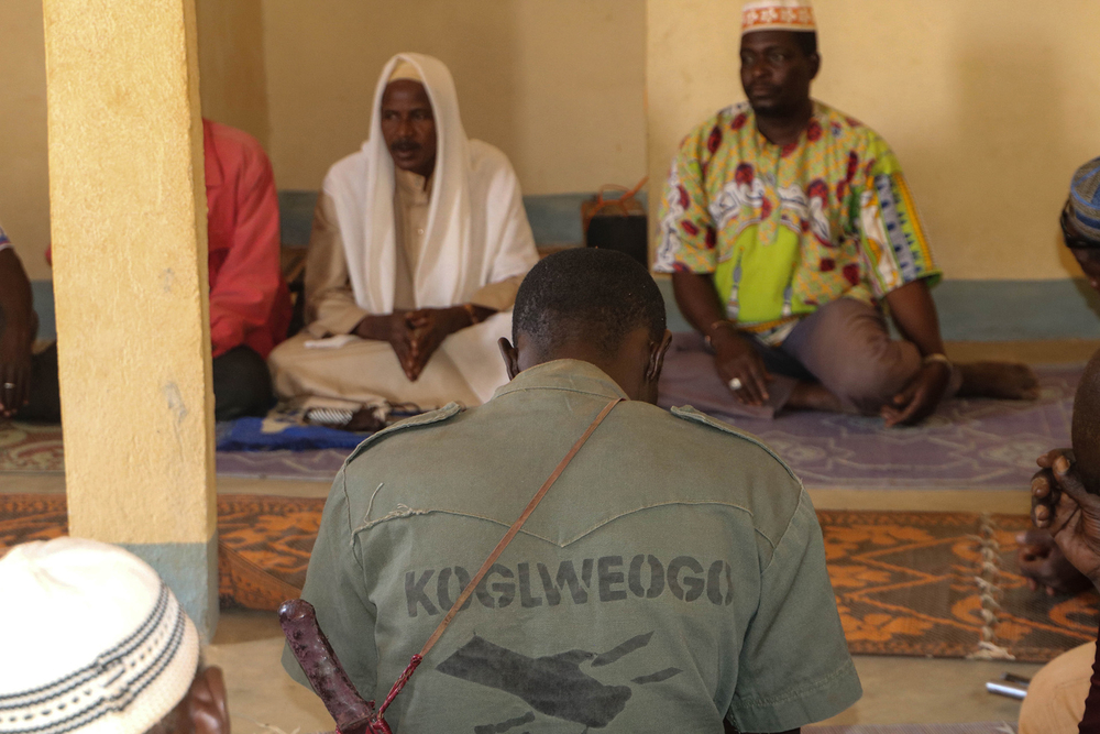 Photo of members of the Koglweogo self-defence group praying together
