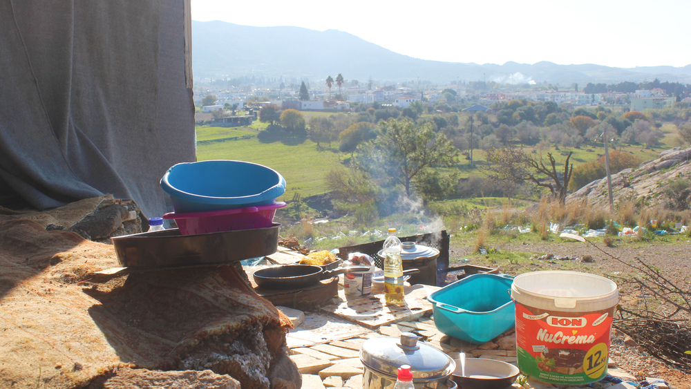 Cooking on the hillside outside the camp in Kos.