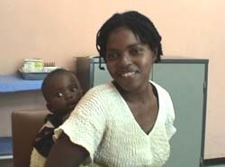 [Zimbabwe] Woman and child waiting for HIV test at a VCT centre.