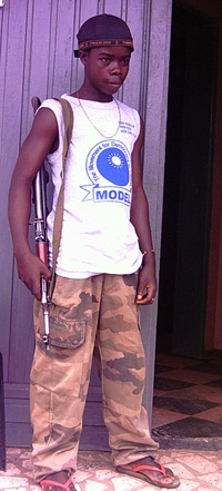 [Liberia] Gbezohngar, a 10-year-old child soldier in Liberia.