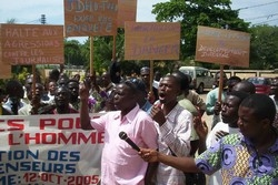 [Togo] Journalists, rights activists and opposition politicians take to the streets of Lome to protest beating of an editor, October 2005.
