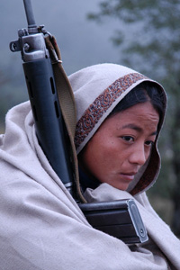 [Nepal] A young female Maoist rebel. Since the start of the conflict between Maoist rebels and Nepali security forces in February 1996, an estimated 12,000 people have been killed. [Date picture taken: 10/26/2005]