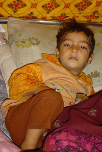 [Pakistan] Sitting in his bed in a field hospital, Safir, 3, is coughing heavily, while his mother, Meerjan, gives him water to soothe the outbursts. The reason is pneumonia, say doctors at the field hospital run by the Pakistan Islamic Medical Associatio