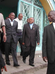 [DRC] President Joseph Kabila (left) accompanied by the president of the Independent Electoral Commission, Apolinnaire Muholongo Malu Malu, leaving a polling station where Kabila voted on the constitutional referendum on 18 December 2005. Photo taken in K
