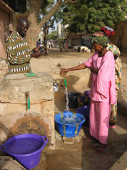 [Senegal] A street standpipe where poorer residents of Dakar come to buy water by the bucket. This one is in Grand Yoff.