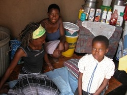 [Zimbabwe] Following the death of their mother, Progress (extreme left) looks after her two sisters, Shipo and Sharon. [Date picture taken: 2005/08/25]
