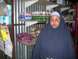 [South Africa/Somali] After mass looting forced her to flee the Masiphumelele township in August, Riqiyou Yusuf, 31, reopened her store for the first time last week. She is waiting to see whether the local Somali community and the neighborhood's business