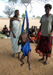 [Kenya] A child is weighed for malnutrition at a mobile feeding center in Turkana, Kenya. [Date picture taken: 10/20/2006]