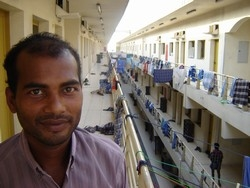 [United Arab Emirates] Mohammad Kamali, 30, stands outside his room in a 2,000-strong 'labour camp' in Dubai. [Date picture taken: 11/09/2006]