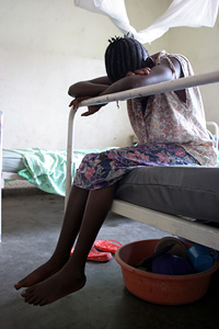 [DRC] A 13-year-old girl, raped by armed men, waits for treatment in a health clinic in Goma, eastern Democratic Republic of Congo, August 2006. During five years of armed conflict in the DRC, tens of thousands of women and girls have suffered crimes of s