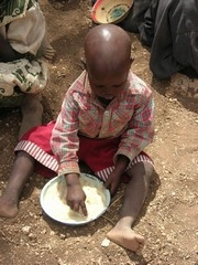 [Kenya] A malnourished child eats maizemeal porridge at Ntungai village, Isiolo District. [Date picture taken: 01/11/2006]