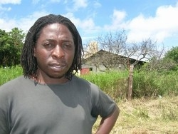 [South Africa] Joseph Makhadi in front of one parcel of land claimed by the Manavhela community. [Date picture taken: February 2006]