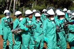 [Tanzania] Some of the 452 workers hired to spray households in Zanzibar in efforts to control malaria-causing mosquitoes on the island. The spraying began on 10 July 2006 and would last 54 days. [Date picture taken: 07/10/2006]