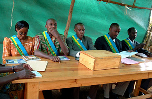 [Rwanda] Judges at a Gacaca court in Rwimbogo, 20 km east of Kigali, Rwanda, August 2005. The Gacaca courts are an indigenous tribunal of justice inspired by the country's tradition and established in 2001, in the wake of the 1994 Rwandan genocide, when
