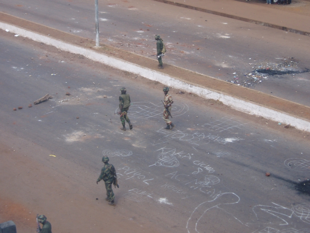 Soldiers on Conakry's deserted streets, enforcing a curfew called after weeks of riots in January and February calling for the resignation of President Lansana Conte, Conakry, 15 February 2007. Guineans and human rights watchdogs say hundreds of unarmed p