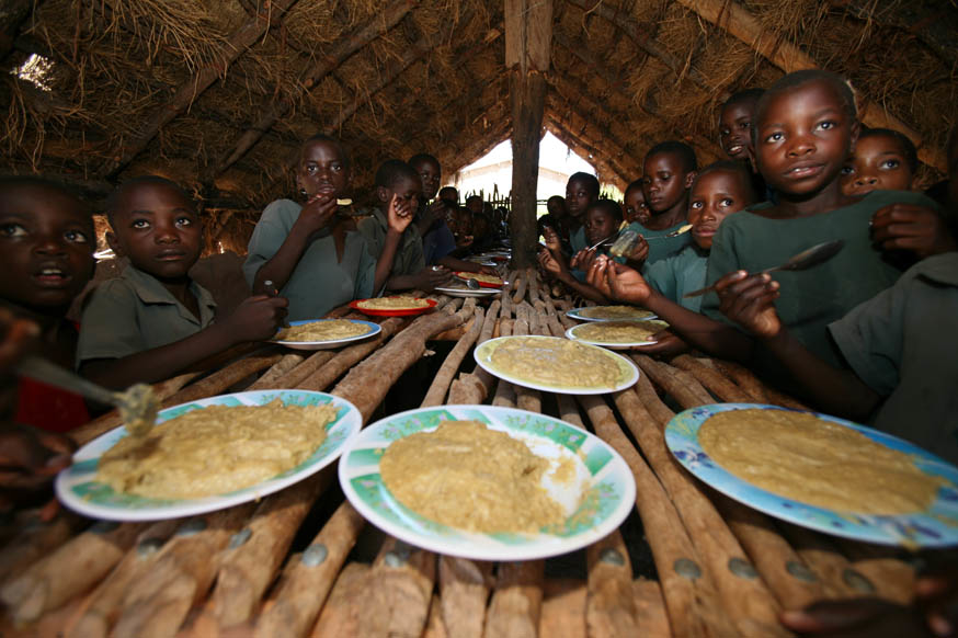 Children enjoy their lunch break at Ngoma School, Sikaneka village, Maamba district, Zambia. February 2007. The UN's Millennium Development Goals for 2015 aim to improve primary education, reduce child mortality, promote gender equality and reverse the