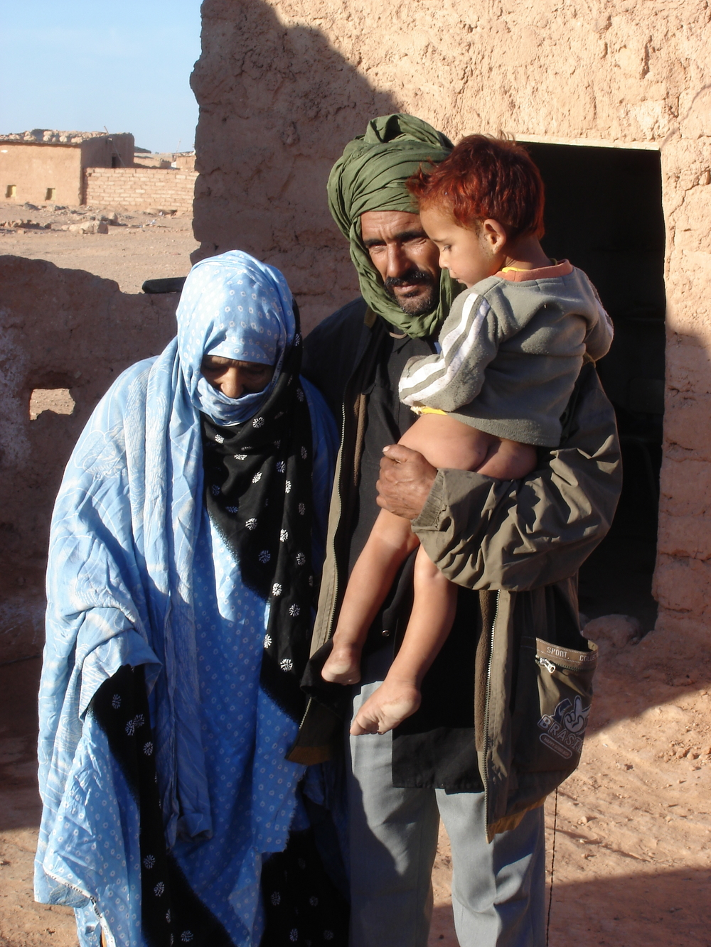 A man with his family, one of the Sahrawi people, Western Sahara, April 2007. The Sahrawi people are divided by minefields, army outposts and a manmade wall of sand more than 2,400 km long. There has been a long-standing dispute that pits the Moroccan gov