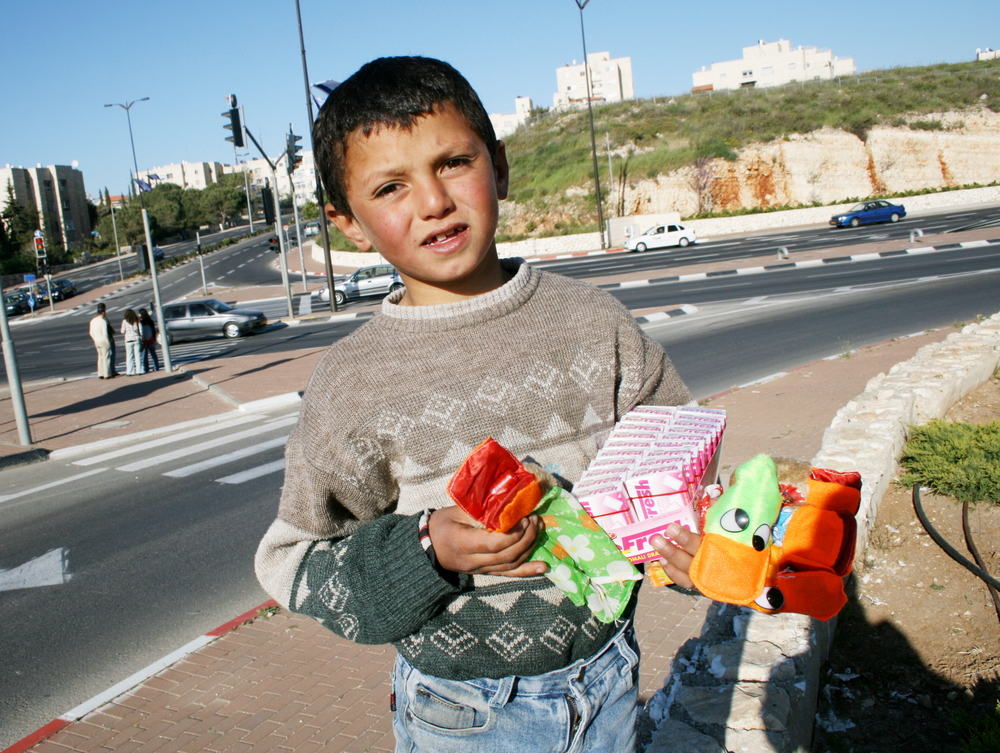 Children such as Younis, 8, do not need a permit to cross Israeli checkpoints.
