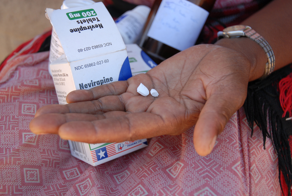 Manthabiseng Matthews holds the anti-retroviral treatment medicine for her granddaughter Limpho in her hand, Lesotho, 20 June 2007.