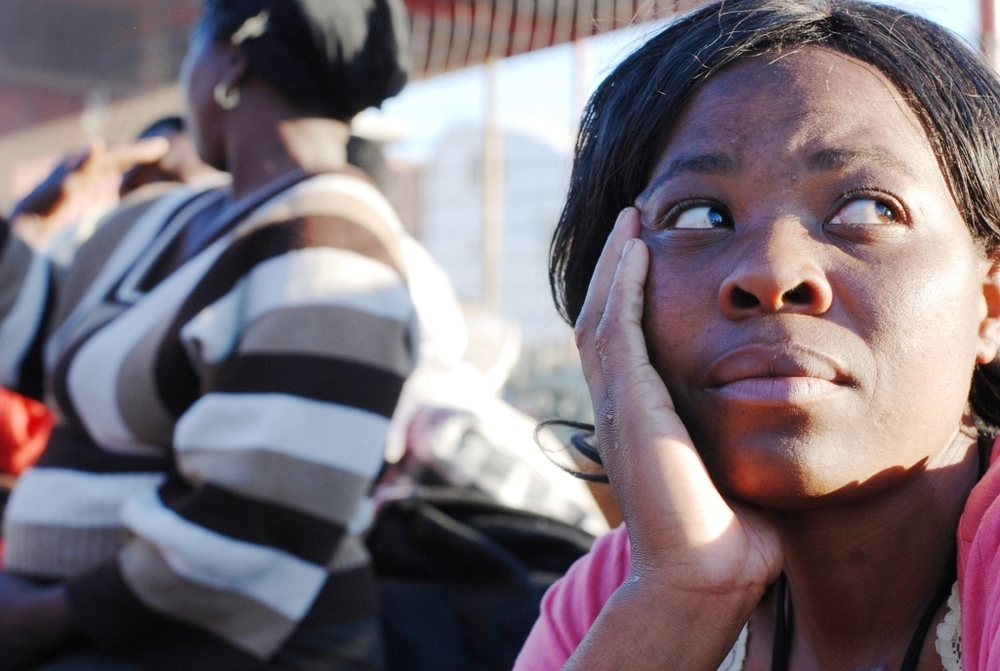 30-year-old Zimbabwean Diana waits at the Beit Bridge border for a truck to take her to Durban where she will sell crafts to earn some money for her children.