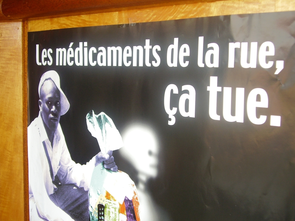 Poster in campaign against fake drugs, trafficked prescription medicines, Abidjan, Cote d'Ivoire ('Street medicines kill').